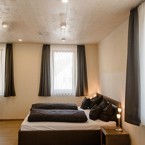 weinscheune-himmelstadt_ferienwohnung-bett2